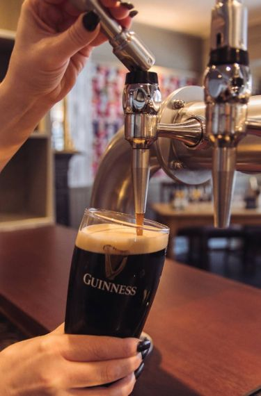 pint of Guiness being poured