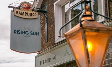 Rising Sun swing sign